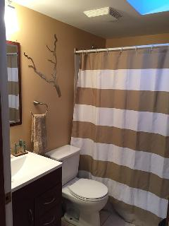 Bathroom with bath tub and shower