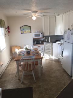 Kitchen off from living room. Full refrigerator, Dishwasher. Microwave, Oven
