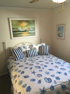 Fresh paint Master Bedroom with 32' TV on wall Queen-size bed and Ceiling Fan