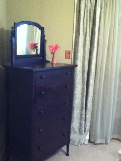 antique dresser in master bedroom