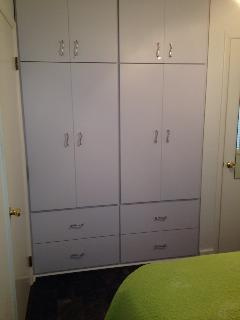 Custom built-in storage in bedroom and new Pergo floor