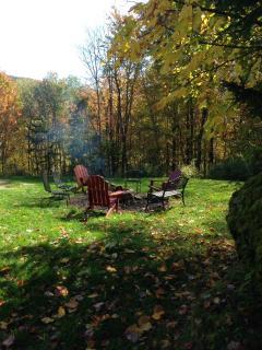 Backyard view of fire pit on a beautiful fall day.