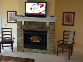 Vizio Smart television and electric fireplace in livingroom