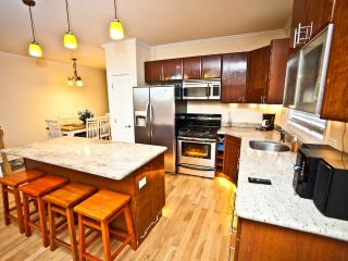 Gourmet Kitchen with Granite Counter Tops and Beautiful Lighting!