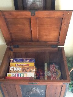 GAME CHEST FOR RAINY DAYS WITH GAMES, CARDS, POKER CHIPS, PLENTY OF BOOKS & DVDS