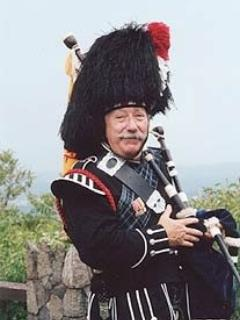 Bagpiper who plays at sunset