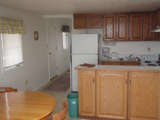 2 bedroom-kitchen with doorwall and view of lake