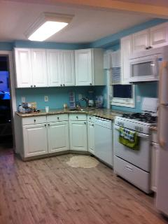 Kitchen, includes many utensils and a Keurig and regular coffee pot.