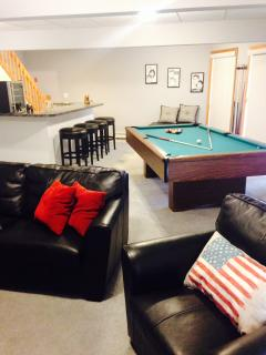 Second living room with bar, pool table and access to the lake w/gorgeous views