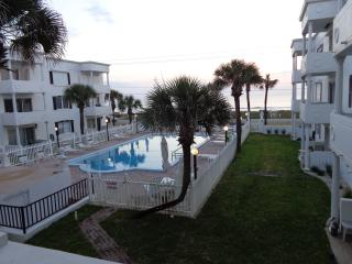 Balcony View of Courtyard Pool & Ocean at Early Daylight