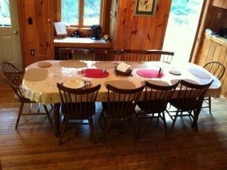 The dining table set for 10.