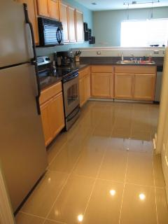 Porcelain tile and stainless appliances.