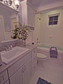 Both upper En Suites have Full Bathrooms with Jetted Soak tubs & heated floors