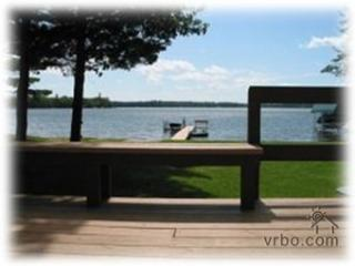 Deck with flat view of lake. Sitting area with table and chairs on deck.