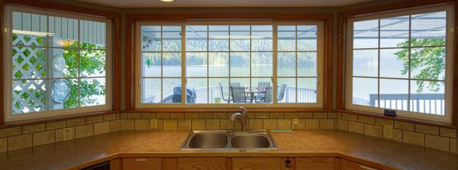 Fully equipped kitchen overlooking the upper deck and lake.