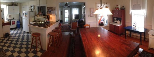 Panoramic view of kitchen (w/cooler), dining room (seats 14) thru living room
