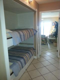 2 single bunk beds in the hallway, closes off for privacy.