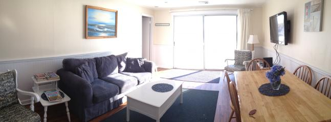 Livingroom with 40 in flat screen wall mounted TV Sliders to deck and beach