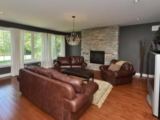 Warm living room with views of Simcoe
