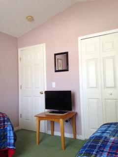 Front Twin Bedroom showing Flatscreen TV, Stand & Closed Closet
