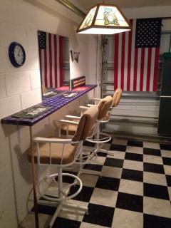 Countertop, Stools, Mirror, Lighting & Flag in Background