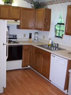 Kitchen fully stocked with silverware, dishes, and cookware. All appliances!