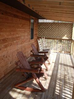Relax in our rockers on a private, covered deck, rain or shine.