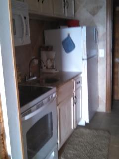 Newly Remodeled Kitchen with full size stove, and refrigerator with ceramic tile