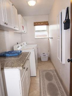 Full size Washer and Dryer along with binoculars for surfer or whale watching