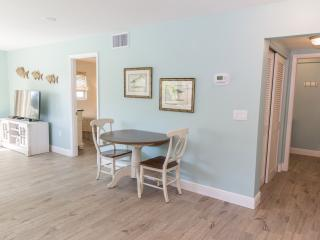 Access to the bathroom from the hall, dinning table will expand to seat 4.