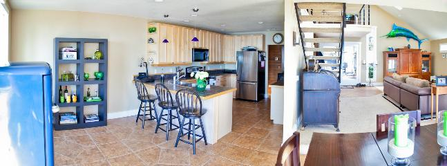 View into the Kitchen and living room from the sliding glass doors water side.
