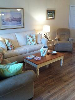 Charming living room with queen sleeper and rare hardwood flooring!