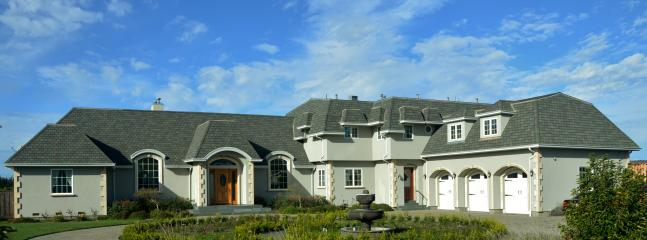 Front view: French country home of 6,00 sf with 5 bedrooms/5 1/2 bath rooms