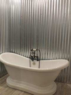Old-fashioned Soaking Tub; bathroom also boasts a custom rainfall shower!