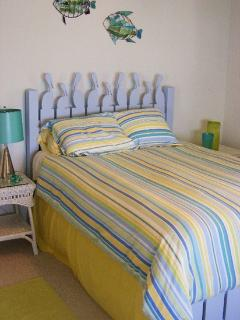 Wake up to the spectacular views of Little Bay. Queen bed w/ attached full bath