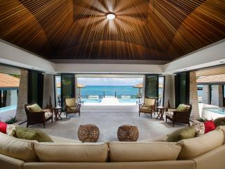 Lounge floats above the resort sized cascading pool, incredible 180° ocean view