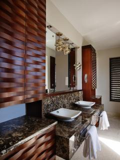 Luxurious twin vanities standard in all suites.