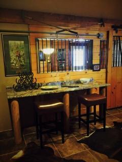 1 Bedroom Unit - Kitchen looking into Living Room