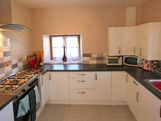 Large kitchen / diner - range cooker, dishwasher, washing machine, fridge freezer and microwave.