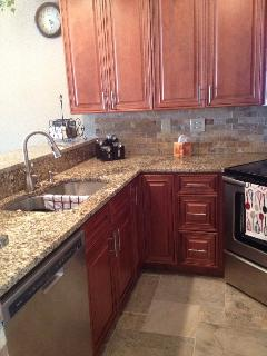 Totally new kitchen with granite countertops and stainless appliances.