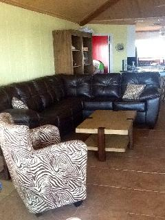 2 Beautiful New Leather Sectional Sofas with Queen Sleeper Sofas, 40\'HD TV.