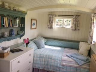 Relax and unwind inside the beautifully furnished 'Bathsheba' the Shepherd's hut.