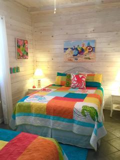 Cheerful Poolside Bedroom. 1 QUEEN, 1 FULL bed.