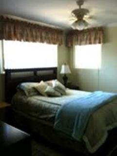 Large unit Bedroom with Queen size bed, dresser and flat screen TV