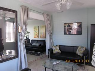 Large unit family room with sleeping sofa and flat screen TV&Drapes for privacy