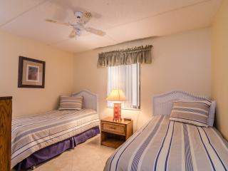 Festive Guest Bedroom with comfy twin beds and ceiling fan!