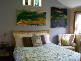 Tranquil bedroom with comfortable queen bed.