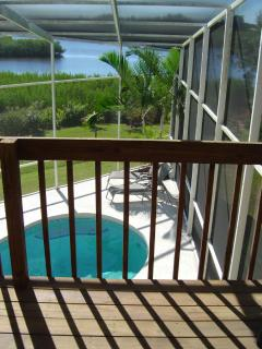 Balcony at master bedroom, great view of the pool and river!