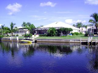 Luxury waterfront home, boat dock, pool, bar.