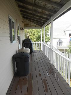Wrap around porch - back with gas grill.